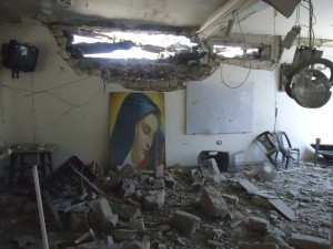 The damaged Im Al-Zinar church is seen in the old city of Homs