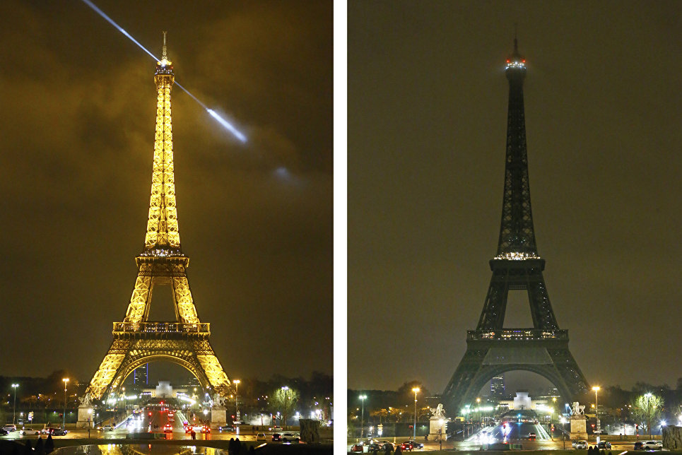 Огни Эйфелевой башни погасли ночью в память о жертвах теракта в Квебеке