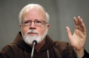 Cardinal O'Malley gestures during briefing at Holy See press office at Vatican