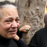 A relative of one of the victims reacts after a church explosion killed at least 21 in Tanta,